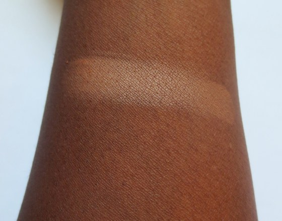 elf pressed powder foundation deep swatch on dark skin
